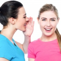 Ilustracja: Two Pretty Young Girls Gossiping by stockimages / FreeDigitalPhotos.net ID-100209473